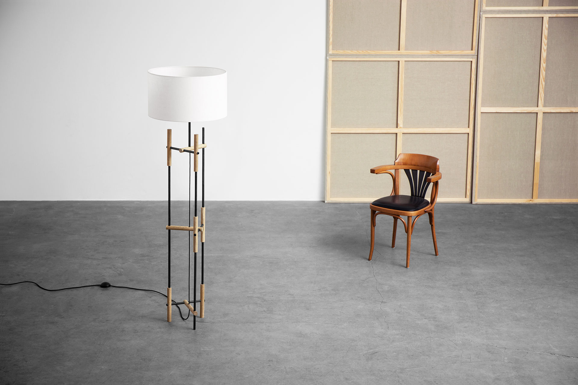 Contemporary design floor lamp with white shade in loft