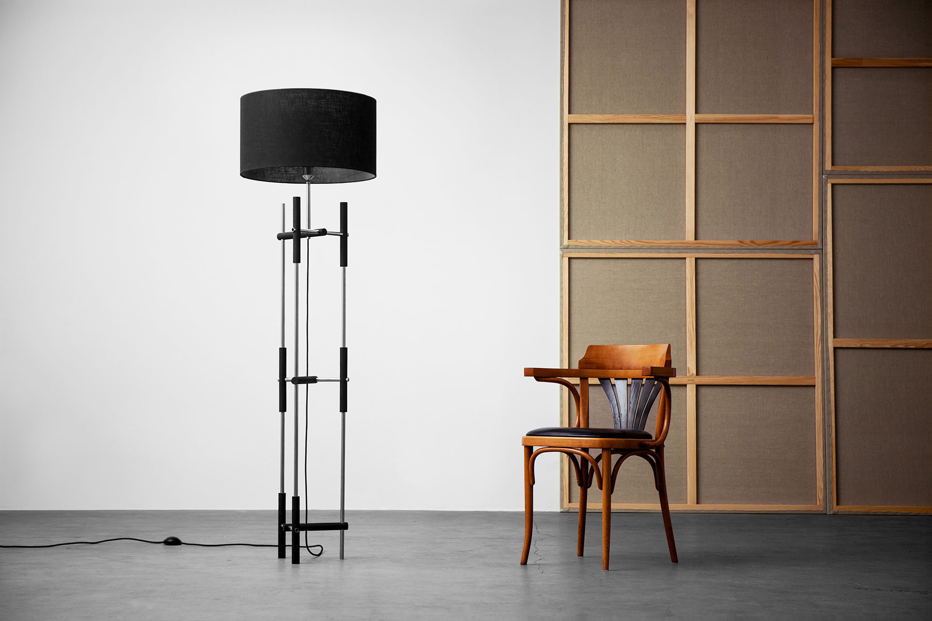 Minimalist design steel floor lamp in loft apartment