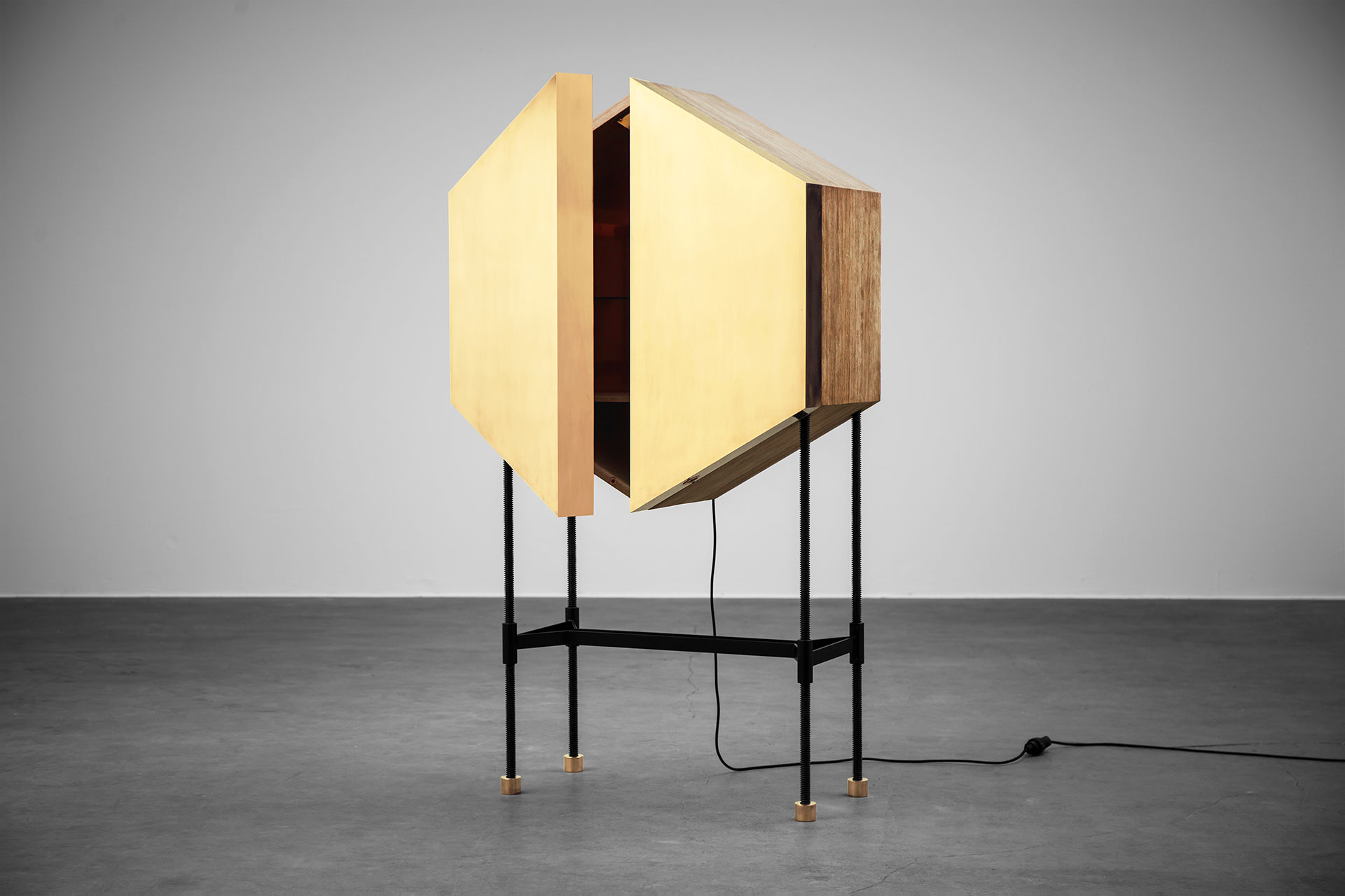 Large bar cabinet with brass doors inspired by brutalism style