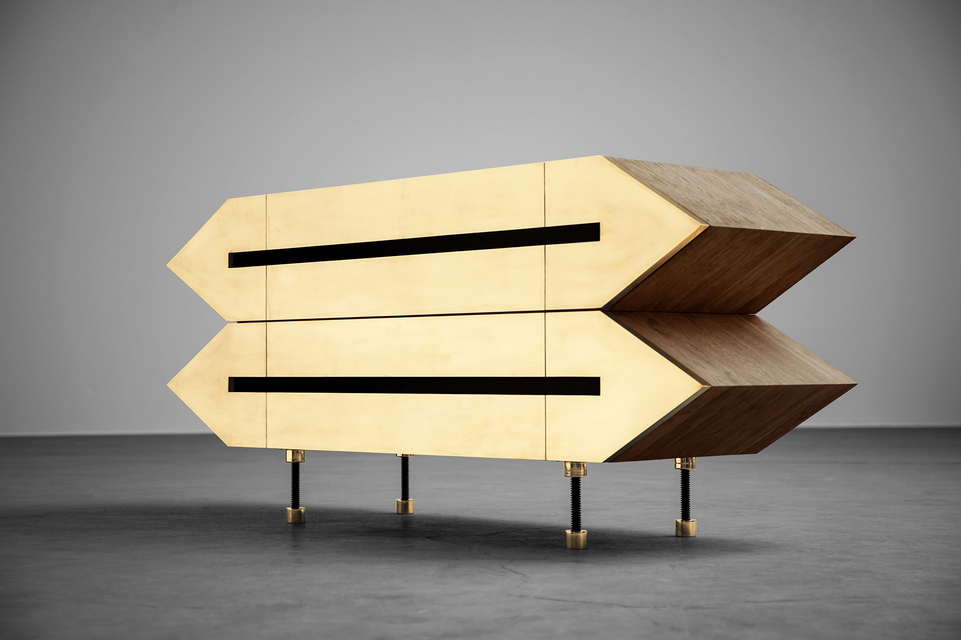 Brutalist design sideboard with brass doors inspired by futuristic architecture