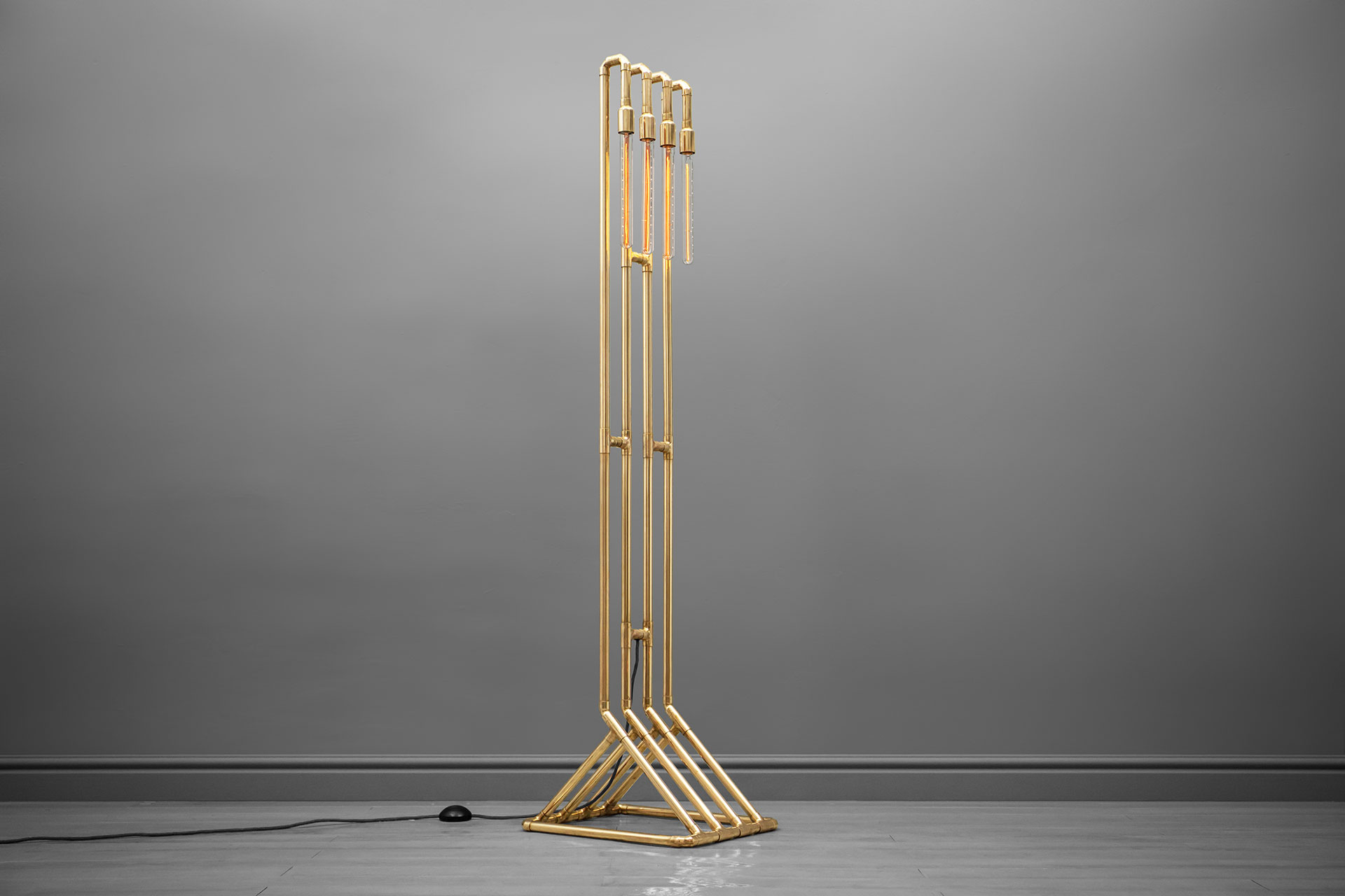 Industrial design floor lamp in trendy copper or gold brass inspired by installation art