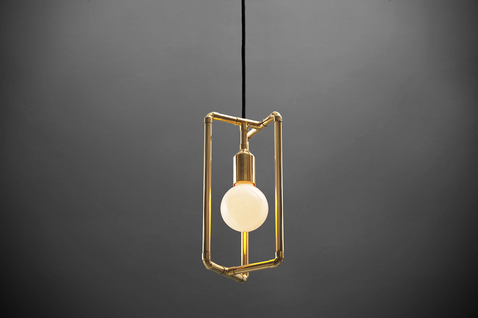 Gold pendant lamp inspired by modern industrial design