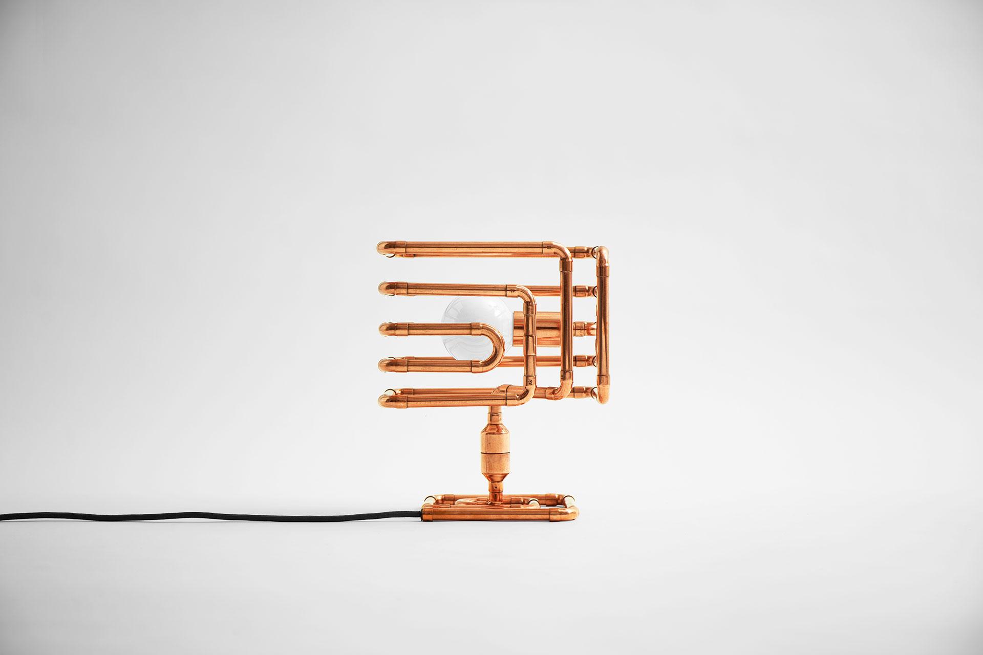 Cool desk lamp in trendy copper metal finish inspired by retro futuristic design