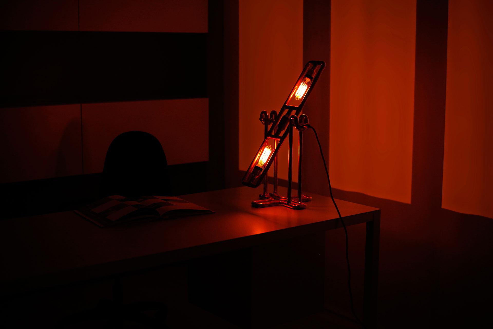 Industrial design desk lamp with vintage Tesla bulbs in modern masculine home office