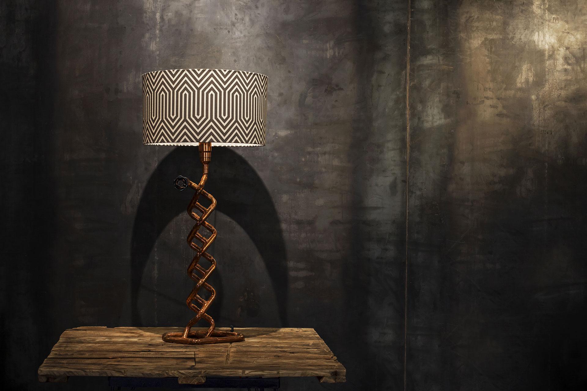 Unique copper console lamp with custom geometric shade in loft style interior