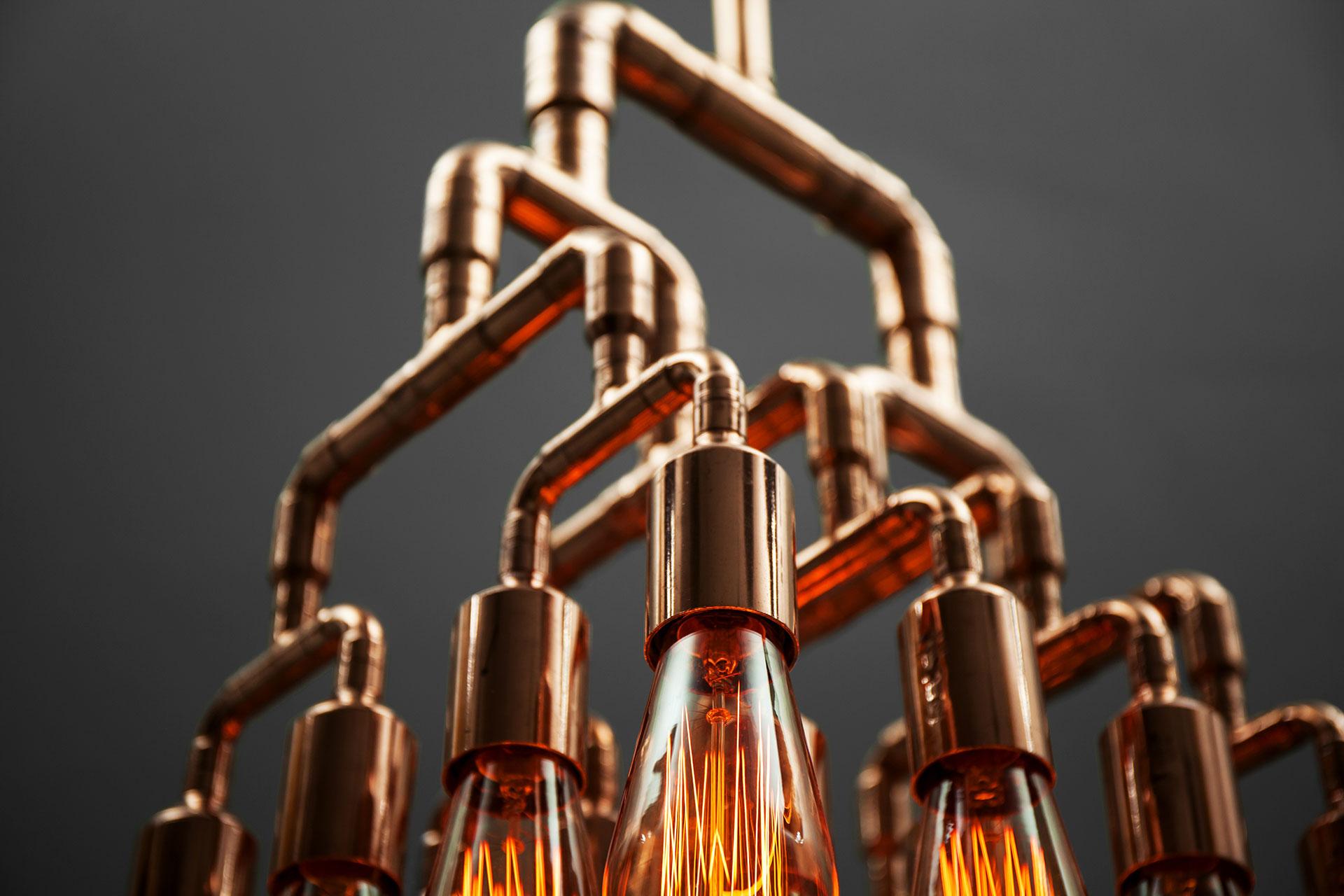 Brutalist design chandelier in trendy copper or brass