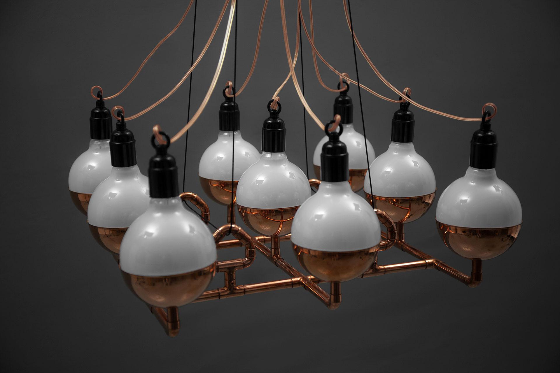 Unique copper chandelier inspired by steampunk design
