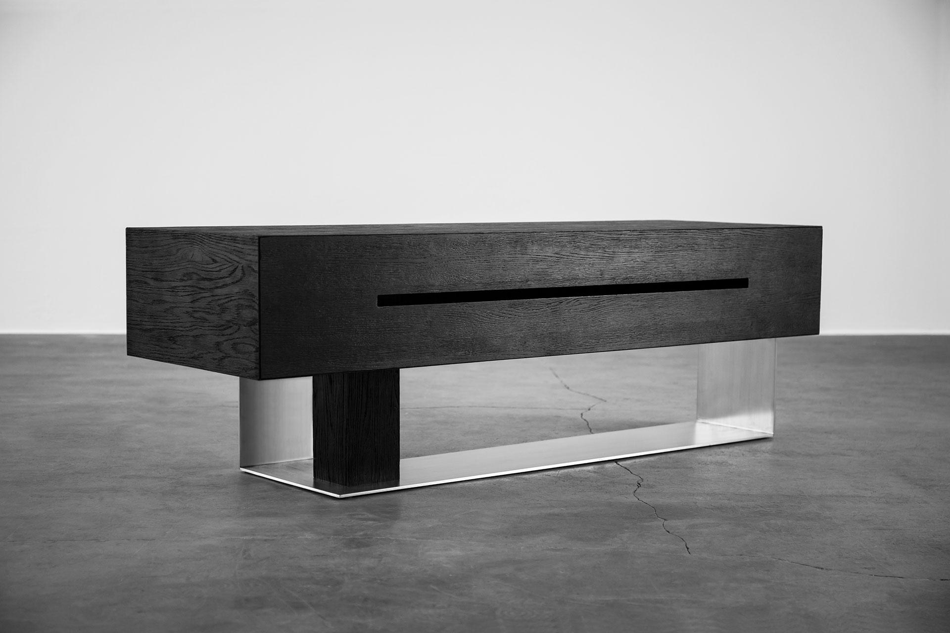 Bog oak media cabinet inspired by brutalist design
