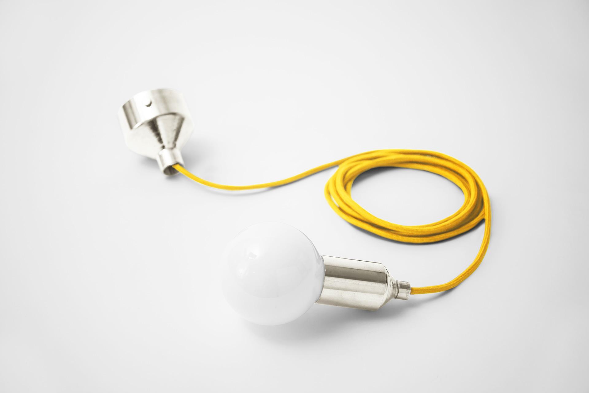 Joyful and fun single pendant light in silver nickel metal finish and with fruit yellow braided cord